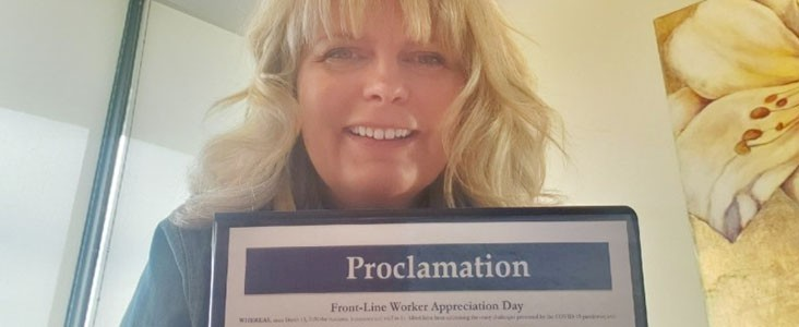 Mayor Heron holding Front-Line Workers Day Proclamation