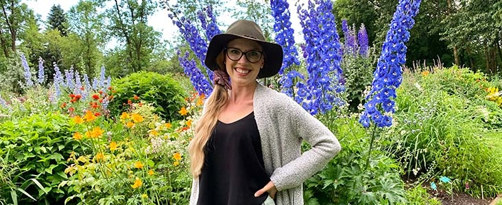 Andrea Lowe standing in front of plants and flowers