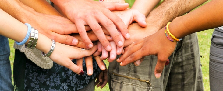 Many hands joined together