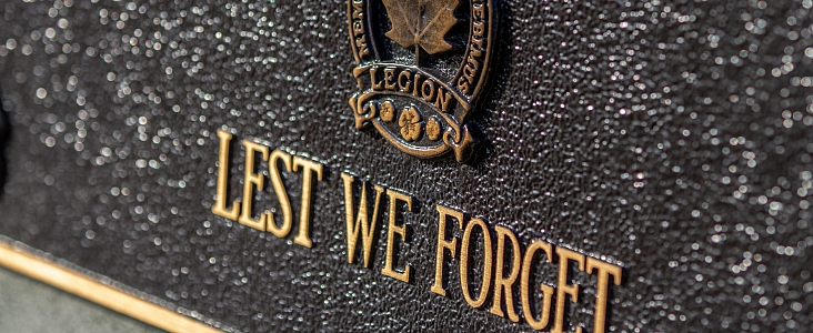Close up photo of cenotaph with the words Lest We Forget