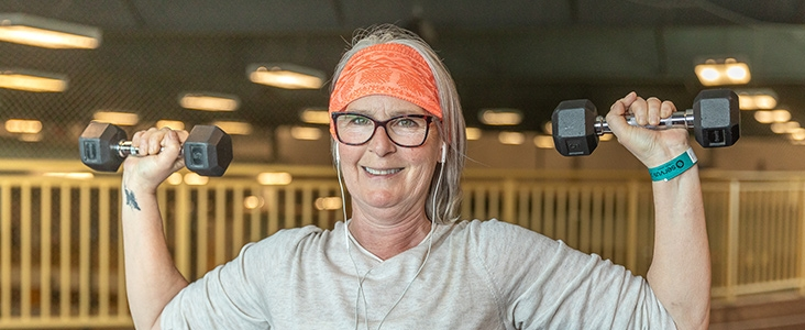 Adult lifting weights at Servus Place