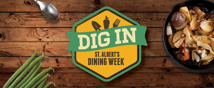 Overview of table with skillet of potatoes and spoon with Dig In Dining Week logo
