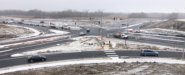 Ray Gibbon Drive intersection after construction with snow