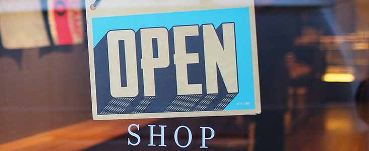 Open sign hanging in the window of a store