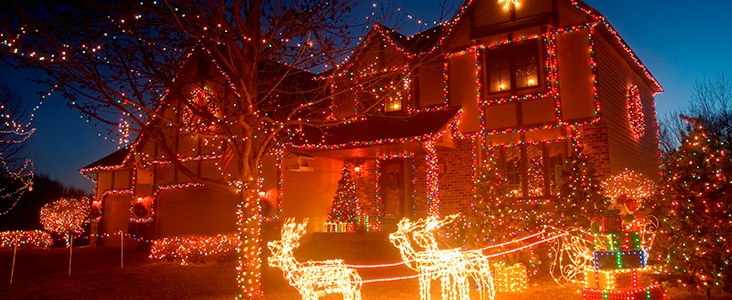 holiday lights on a house at night