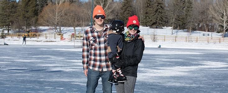 Family skating at Lacombe Lake Park in St. Albert