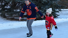 Parent and child skate on the freezeway at Lions Park