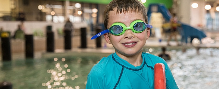 A smiling child is enjoying swim time at Fountain Park