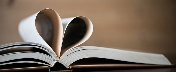 photos of a book with open pages making the shape of a heart