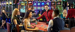 Stylish people gamble at the roulette table