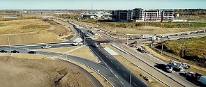 Aerial view of Ray Gibbon Drive and Leclair Way intersection during phase 1 of construction