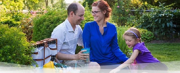 A family enjoys a picnic at the Botanical Garden