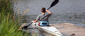 A kayaker wades out into the Sturgeon River