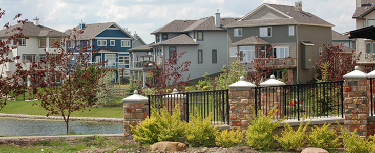 A picture of several homes backing on to a stormwater pond in North Ridge