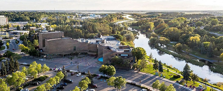 Aerial view of St. Albert Place and the Sturgeon River facing west