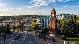 Aerial view of downtown St. Albert with a blue sky and vantage point of the clock tower.