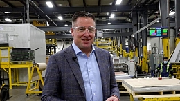 Orion Plastics owner standing in warehouse.