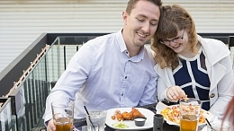 Couple on a patio eating appetizers.