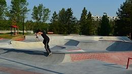 Skater rides a rail at the Woodlands Skatepark in Saint Albert, Alberta