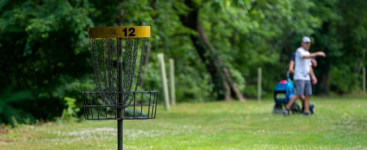 Player throws a disc during a disc golf round