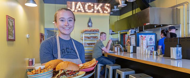 A server welcomes you to Jacks Restaurant