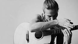 Black and white photo of Calum Graham playing guitar
