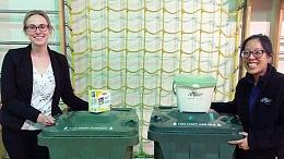 Waste team showcasing waste bins at a school - photo taken pre-pandemic