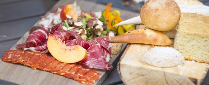 A charcuterie board is presented to eager customers at a St. Albert restaurant.
