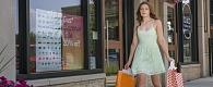 A woman carries shopping bags away from a St. Albert shop