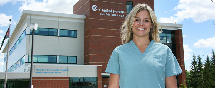 Health Care professional in front of Sturgeon Community Hospital