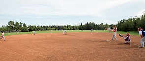 Kids playing baseball on a baseball diamond