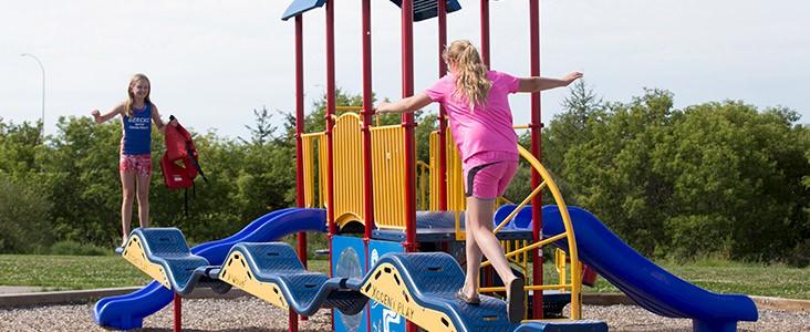 Children playing on playground equipment