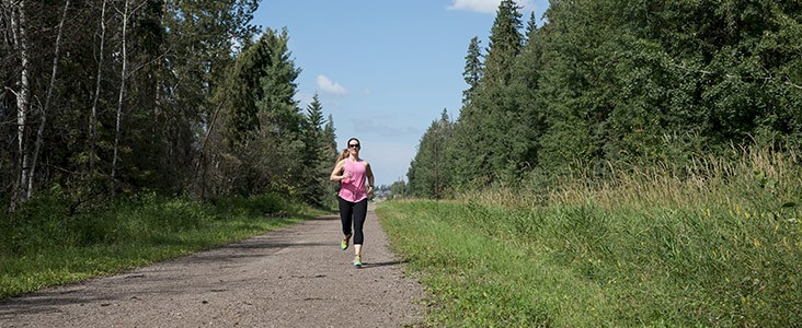 Woman running in Grey Nuns White Spruce Park