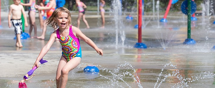 Kids playing a a water play park.