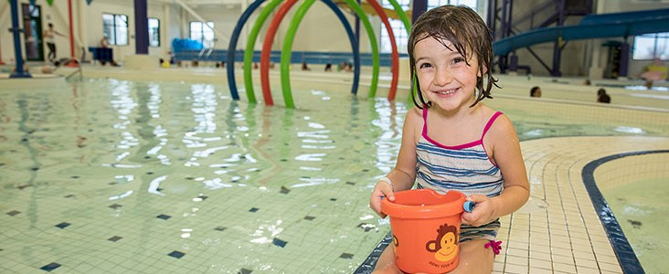 Photo of young swimmer at Landrex Water Play Centre; holding a water toy