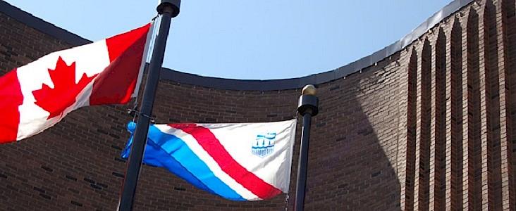 Flag poles outside city hall.
