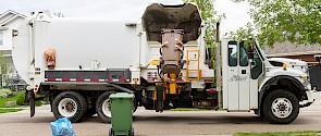garbage truck collecting garbage
