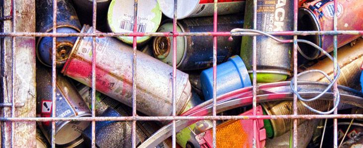 Cans inside a metal basket.