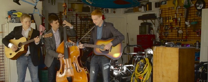 Photo of the band of three men performing in a garage