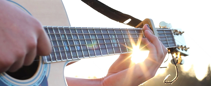 Person playing guitar outside