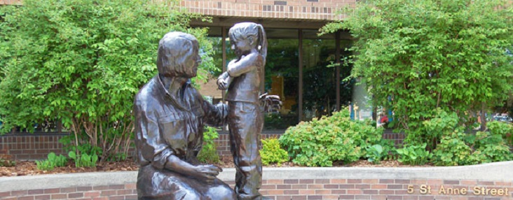 Photo of a Bronze Statue with a woman and little girl