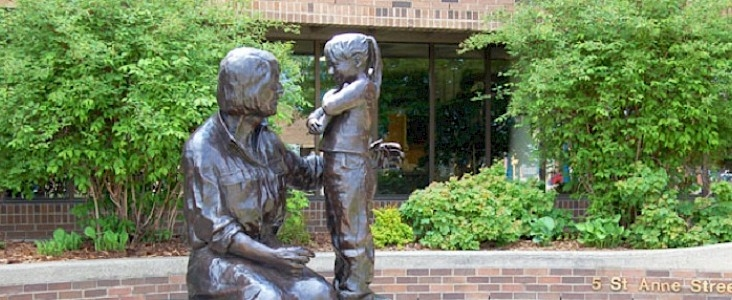 A Bronze Statue of Lois Hole and little girl