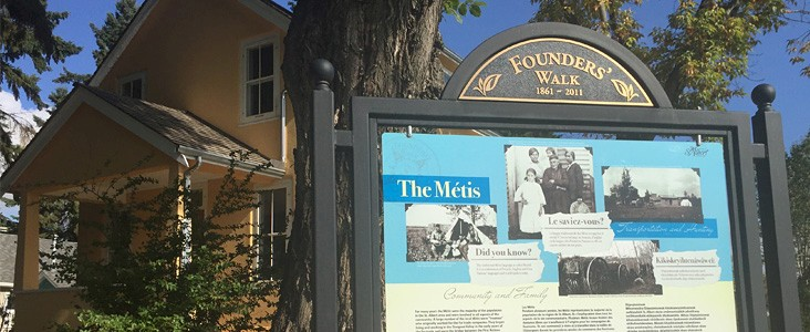 A Founders Walk display sits outside of Michif Cultural Connections