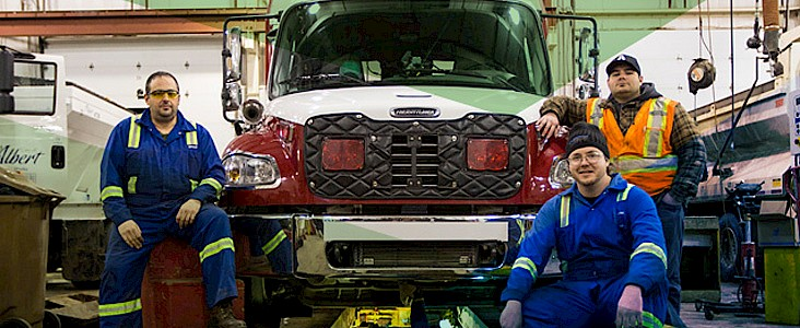 A Public Works crew conducting maintenance work on a Fire Services vehicle.
