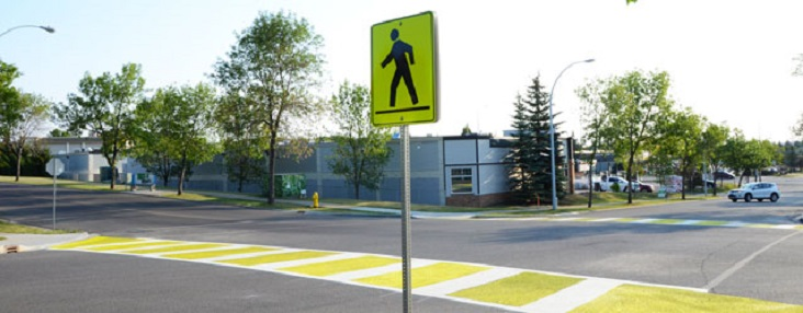Picture of yellow cross walk sign and yellow cross walk