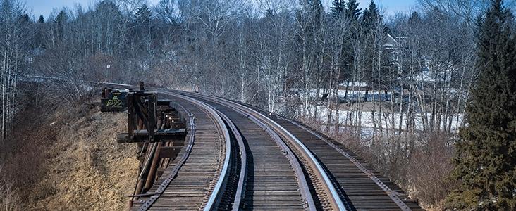 Train track over trestle bridge in St. Albert