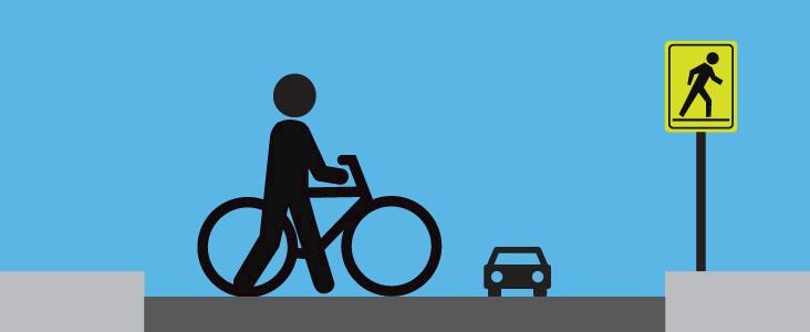 Illustration of person walking bike across a street