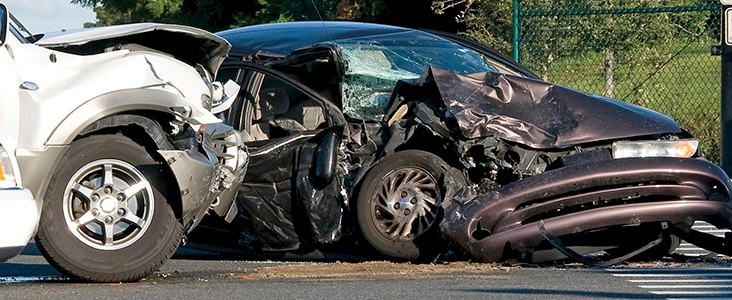 Photo of two vehicles in a accident with major damage