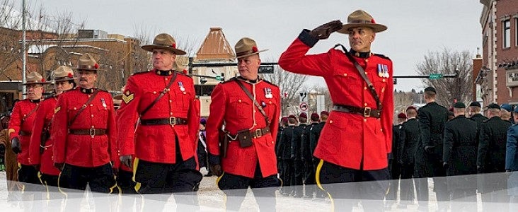 Photo of RCMP officers marching at RCMP Constable David Wynn's funeral