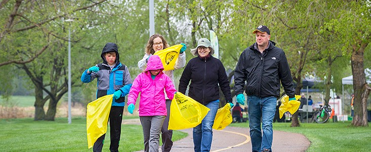 Photo of family walking with bags at Riverfest